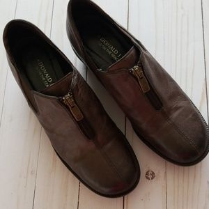 Donald Pliner loafer style shoe with wedge heel